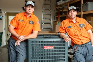 two-technicians-devin-scott-leaning-on-ac