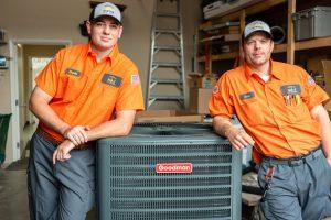 two-technicians-devin-scott-leaning-on-ac
