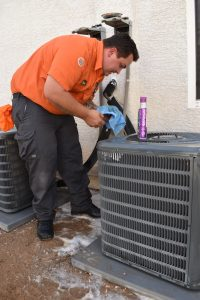 technician-cleaning-outdoor-ac