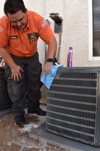 technician-cleaning-outdoor-ac-unit-2