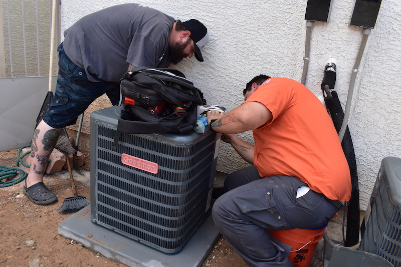 technicians-working-on-AC-unit