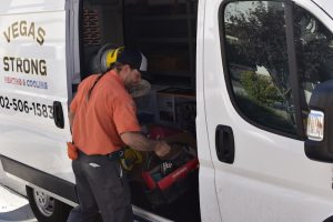 technician-removing-tools-from-truck