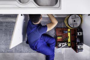 Plumber-underneath-sink